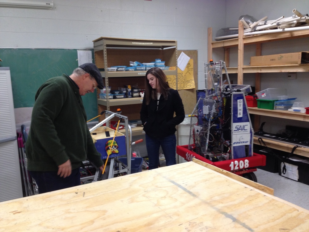 Team 1208 mentor, Mr. Curry, and former team member, Adrienne Bowman, in the new workshop (The Botcave)