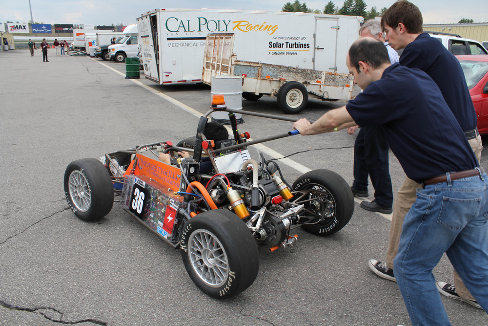 Pushing the car to an event at competition