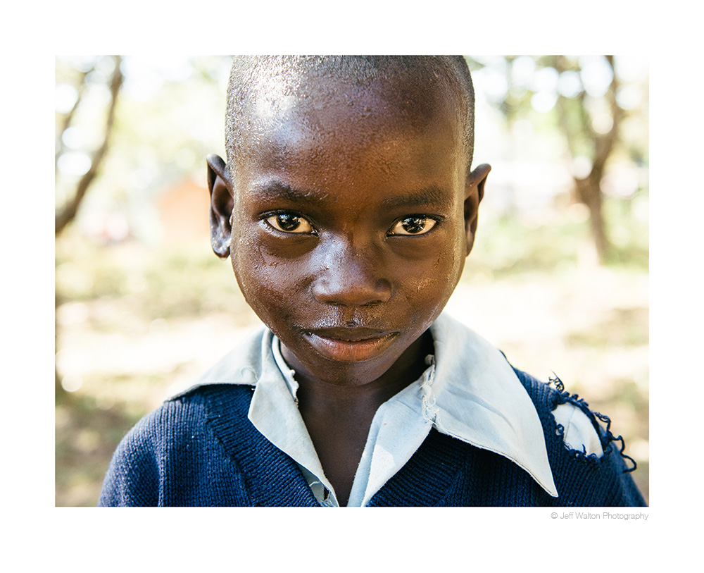 School boy in Zambia by Jeff Walton Photography