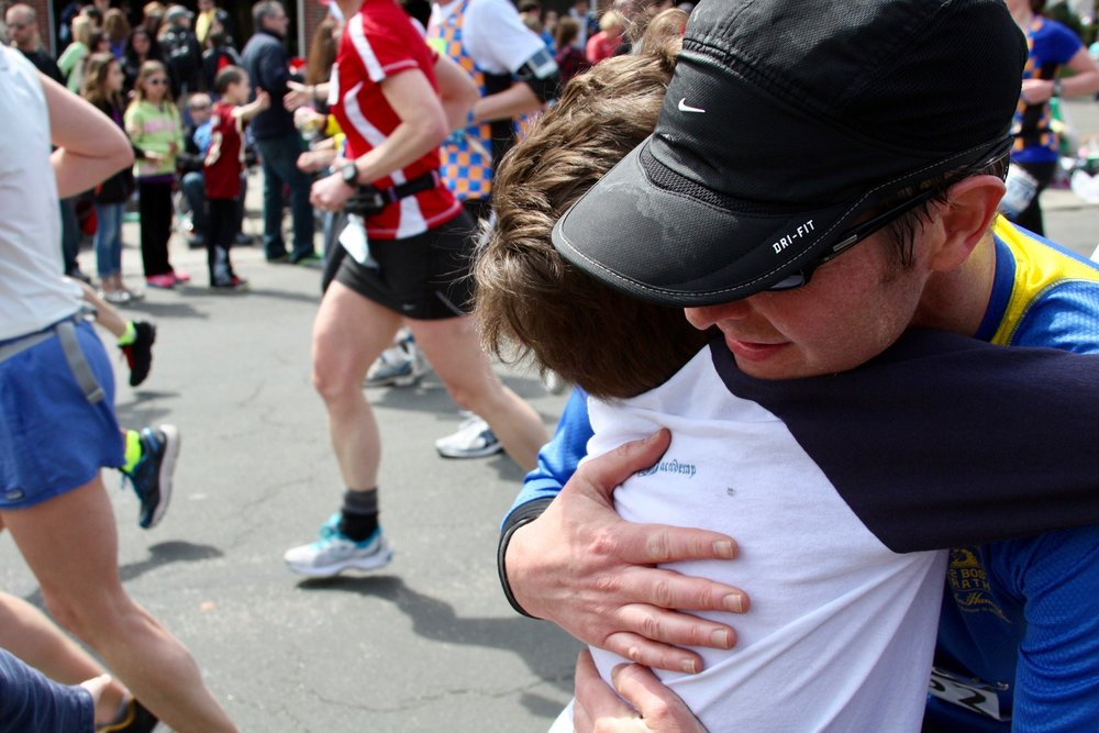 Here I give my oldest son an embrace at mile 17 on April 15, 2013. One hour after this photo was taken I was on Boylston Street when the first bomb exploded in front of me. 12 seconds after that the second bomb detonated behind me. At that time my family had also made their way to Boylston street and were waiting there to watch me cross the finish line. I never did, but we met up a short time later . . . shaken but unhurt; relieved to be reunited.  Read more about my experience in an EPSN.com feature here.