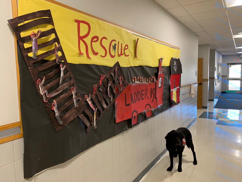 Rescue in front of a kid art tribute to brave firefighters—for whom Rescue is named! :)