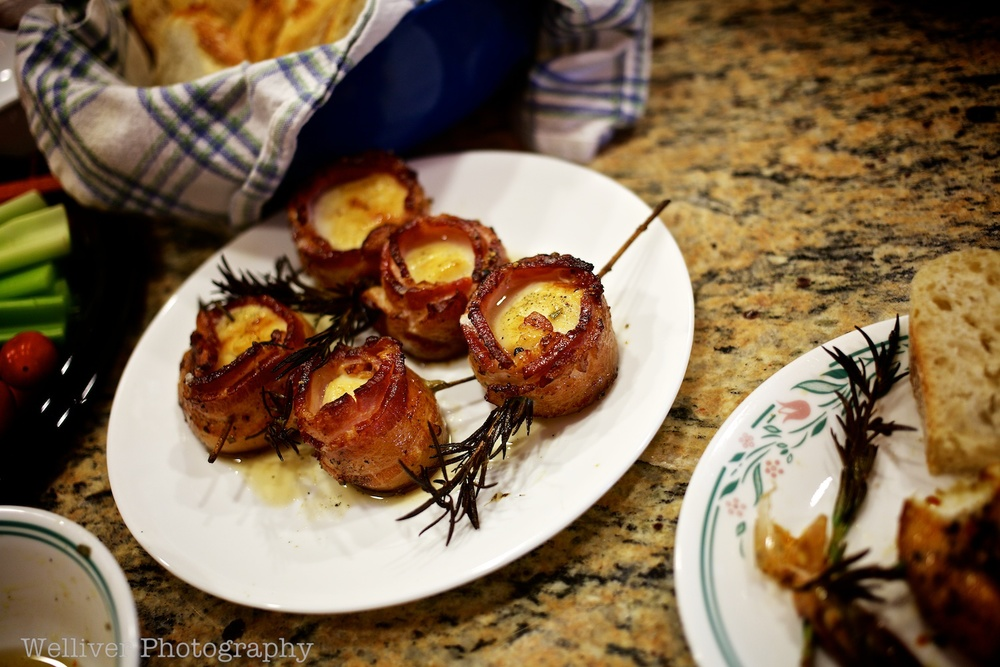 Key appetizer before crabs...bacon wrapped scallops with rosemary skewers.