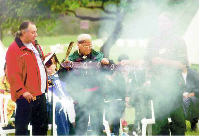 Grandfather William Commanda shares the Seven Fires prophecy belt at the One Prayer gathering, 2000.