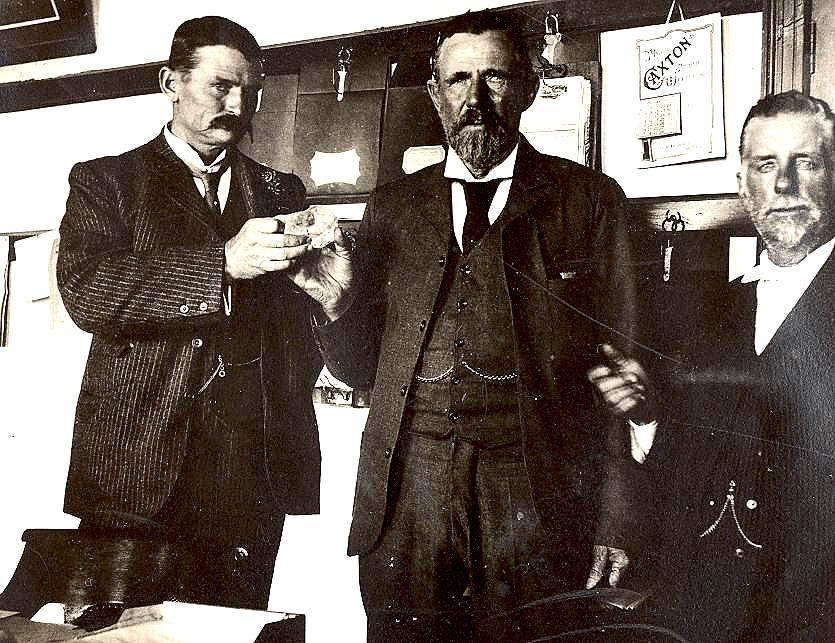 "Captain Frederick Wells, superintendent of Premier Mine, one of South Africa's most productive mines, near Pretoria, found the diamond, during his daily inspection of the mines, on the 26th of January, 1905. During his rounds he saw a flash of light, reflected by the sun on the wall of the shaft. As he got closer, he could see a partially exposed crystal, embedded in the rock, however he initially believed it to be a shard of glass, placed by one of the miners as a practical joke. Using just his pocket knife he managed to release the diamond. At 1 1/3 lbs, 3 7/8 inches long, 2 1/4 inches wide and 2 5/8 inches high the diamond was twice the size of any diamond previously discovered. Wells immediately took it for examination. Sir William Crookes performed an analysis of the stone, ascertaining a weight of 3,106 carats. The stone was immediately named after Sir Thomas Cullinan, the owner of the mine.  Crookes mentioned its remarkable clarity, but also a black spot in the middle. The colours around the black spot were very vivid and changed as the analyser was turned. According to Crookes, this pointed to internal strain.  Such strain is not uncommon in diamonds. Because one side of the diamond was perfectly smooth, it was concluded that the stone had originally been part of a much larger diamond, that had been broken up by natural forces. Crookes commented that ""a fragment, probably less than half, of a distorted octahedral crystal; the other portions still await discovery by some fortunate miner.""  Naturally the discovery became a global sensation, with the developments being followed avidly by the press. Wells was awarded ₤3,500 for his find and the diamond was purchased by the Transvaal government for ₤150,000 and insured for ten times the amount. The Prime Minister Botha suggested that the diamond be presented to King Edward VII as 'a token of the loyalty and attachment of the people of Transvaal to his throne and person'. A vote was staged in order for the government to find out what should be done with the diamond. Oddly enough, in the aftermath of the Boer War the Boers voted in favour of presenting the king with the diamond and the English settlers voting against such a move. The final vote was 42 against and 19 in favour. In the wake the vote, the British Prime Minister of the time Sir Henry Campbell-Bannerman decided to leave the decision of whether to accept the gift up to the king himself. However, later prime minister, Winston Churchill eventually managed to persuade the king to accept, to which Edward VII finally agreed. Churchill was presented with a replica of the diamond, which he allegedly delighted in showing off to friends and displaying it on a silver plate."