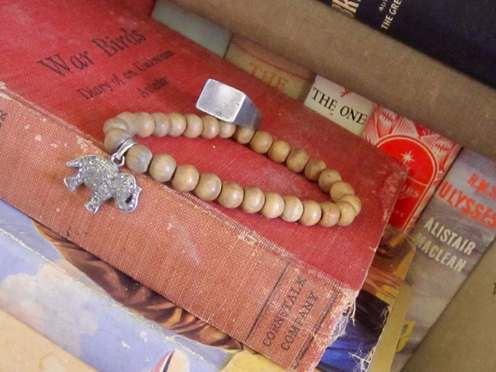 Faded beauty: vintage cloth-bound books shown here with VIX Jewellery distressed signet ring and faded Sandalwood Bead Pave Diamond Bracelet  http://tinyurl.com/kg9ukc4