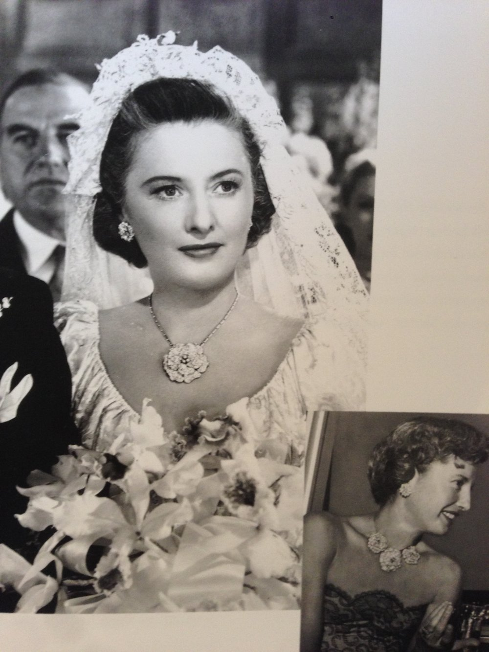 "Barbara Stanwyck wearing her own platinum and diamond Gardenia necklace by William Ruser.  The gardenias are detachable and she wears just one in the movie still from ""Sorry, Wrong Number""."