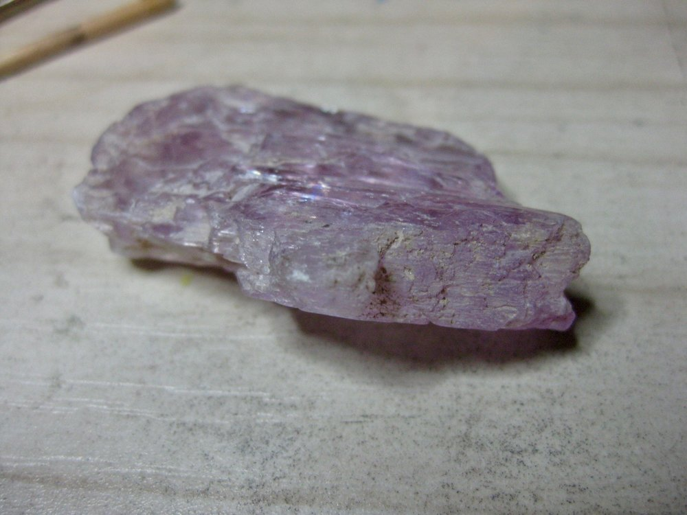 A really nice piece of Kunzite. As I cut and polished this, it cleaved into a mere shadow of its former size.  That is one of the risks a lapidary faces.  As careful as you can be, you just never know when part of it will give way!