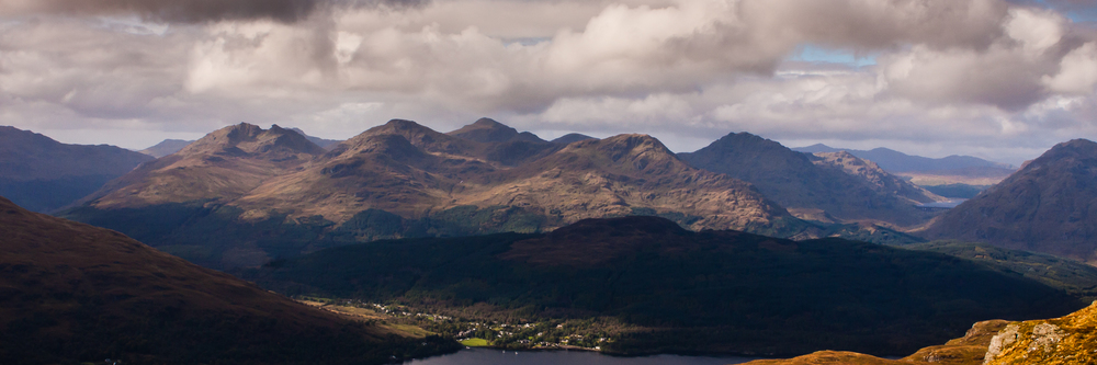 The Arrochar Alps, seen in summer from Ben Lomond. A nice enough image, just forgot about it and figured it didn't really have enough punch to work well. Also, the annoying bit of hill on the bottom right.