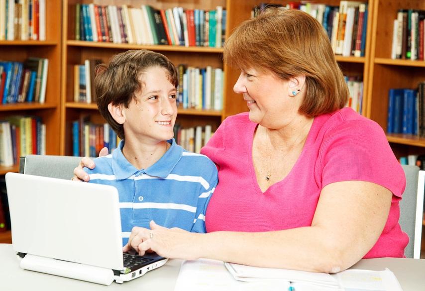 013702745 mother or teacher helping a li.jpg