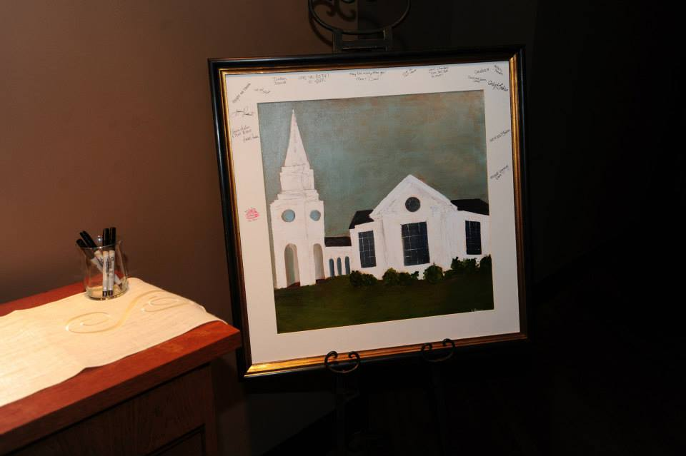 I absolutely ADORED the couple's alternative to the guest book. They had an illustrator paint a gorgeous depiction of their wedding chapel, which was matted and framed for guests to sign, to be hung in the couple's home after the wedding.