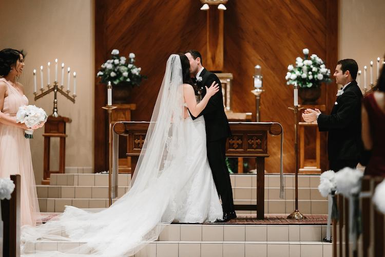 catholic wedding kiss
