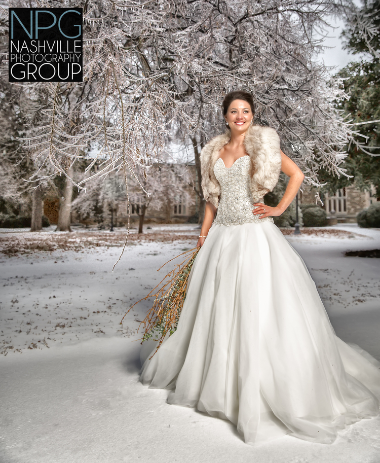 One of our past winter brides on a (used to be rare) snowy day -- shot by  Jeb Wilson of Nashville Photography Group