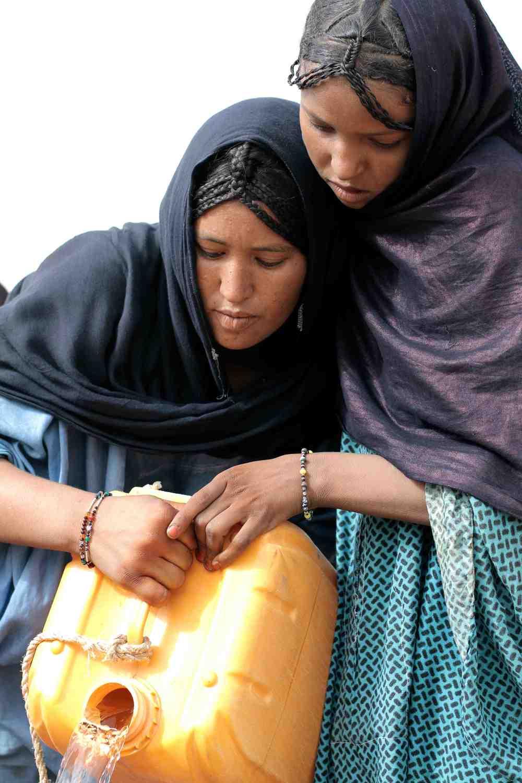 Tuareg girls fetching water