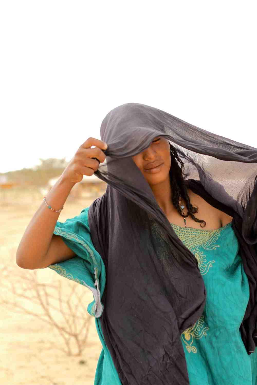 A Tuareg Woman Adjusts her Veil