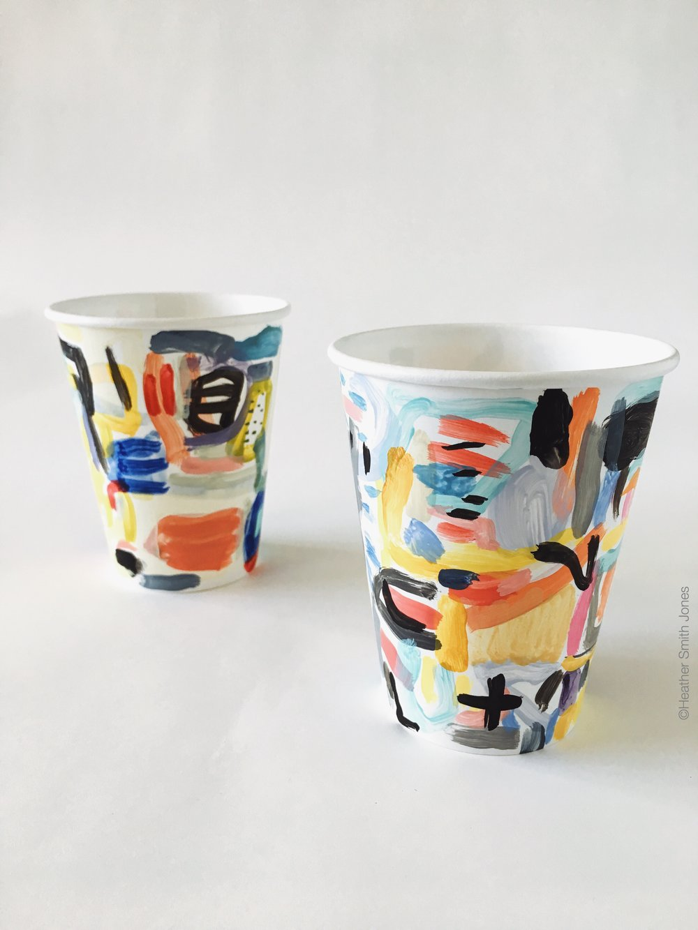 Two cups I painted for the #CautionMayBeHot exhibit on view at Long Weekend.