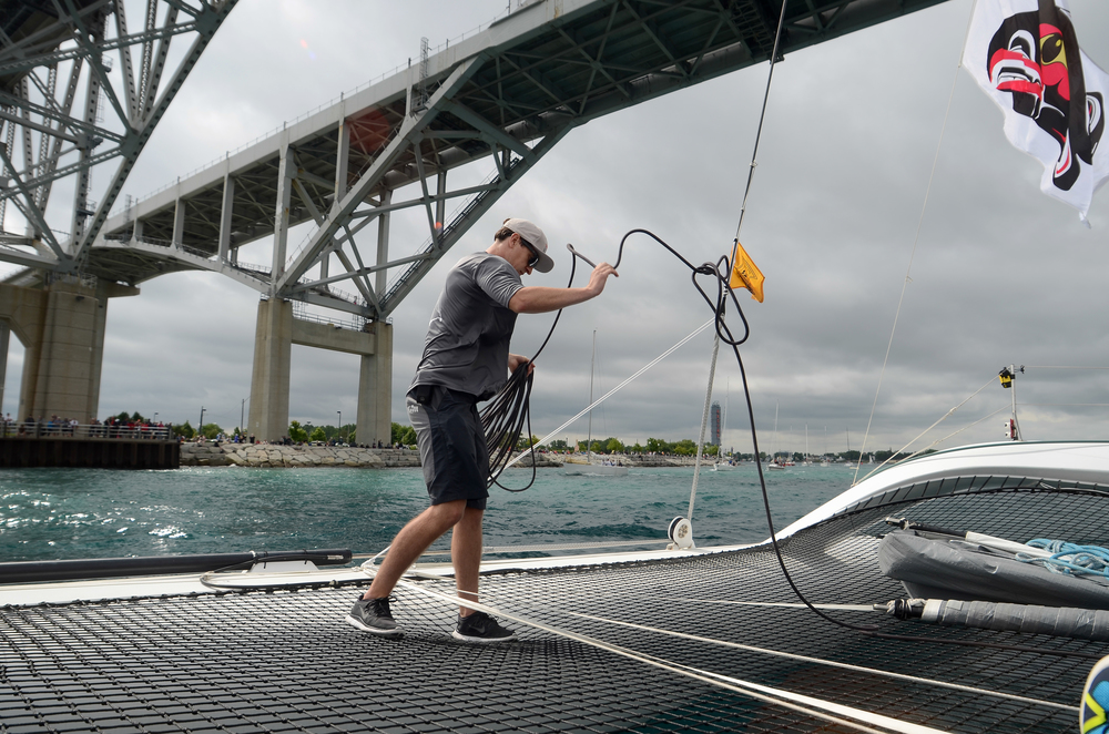 Matt secures a line under the Blue Water Bridge heading out to the start of the Mackinac Race.