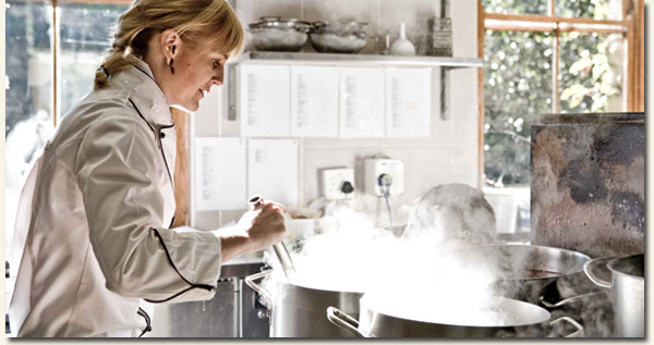 Chef Jackie Cameron in the Hartford House kitchen / Cooked in Africa (p)