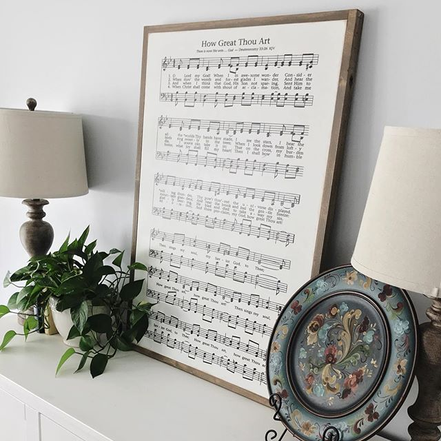 "I am absolutely in LOVE with this new addition to our living room! @anfrew22 surprised me for Christmas with this GORGEOUS 2x3ft printed hymn- ""How Great Thou Art"". I can't stop staring at it. What a beautiful daily reminder of the goodness and mercy of God. . . . #homedecor #farmhouse #farmhousestyle #fixerupper #hymns #howgreatthouart #art #livingroom #decor #plants #greenthumb #worship #howgreat #thankful #blessed #unique #beautiful"
