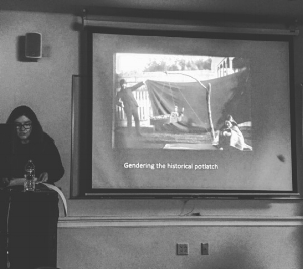 "Robertson shows a slide of a photograph of anthropologist Franz Boaz in which she points out how Boaz was ""literally holding up a blanket to cover a white picket fence behind him."" By covering the fence, Boaz tried to recreate the world he imaged, a wilderness perhaps, before European contact. By contextualizing her voice and the voices of the people involved in the representation of Cook, Robertson's approach offered guidance as to how understanding forms of social knowledge within politically and culturally sensitive contexts is essential to how we see ourselves in relation to one another."