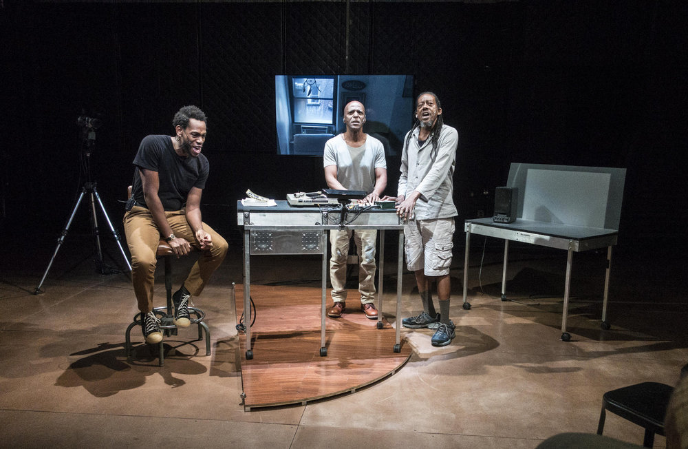 Eric Berryman, Jasper McGruder and Philip Moore sing. Photo captured by Bruce Jackson.