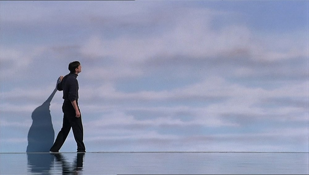 "Jim Carrey discovering the limits of his world in ""The Truman Show"""