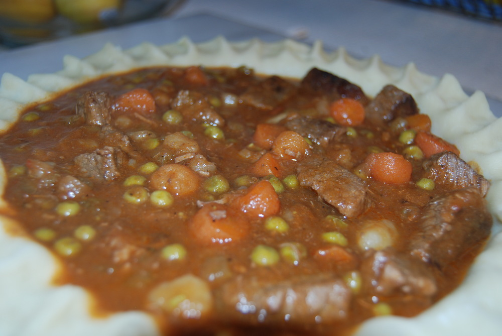 Beef pie filled shell ready for top crust.jpg