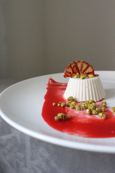 Vanilla Panna Cotta.  I made my own sauce of blood orange, strawberry and raspberry sauce with cardamom and orange zest.