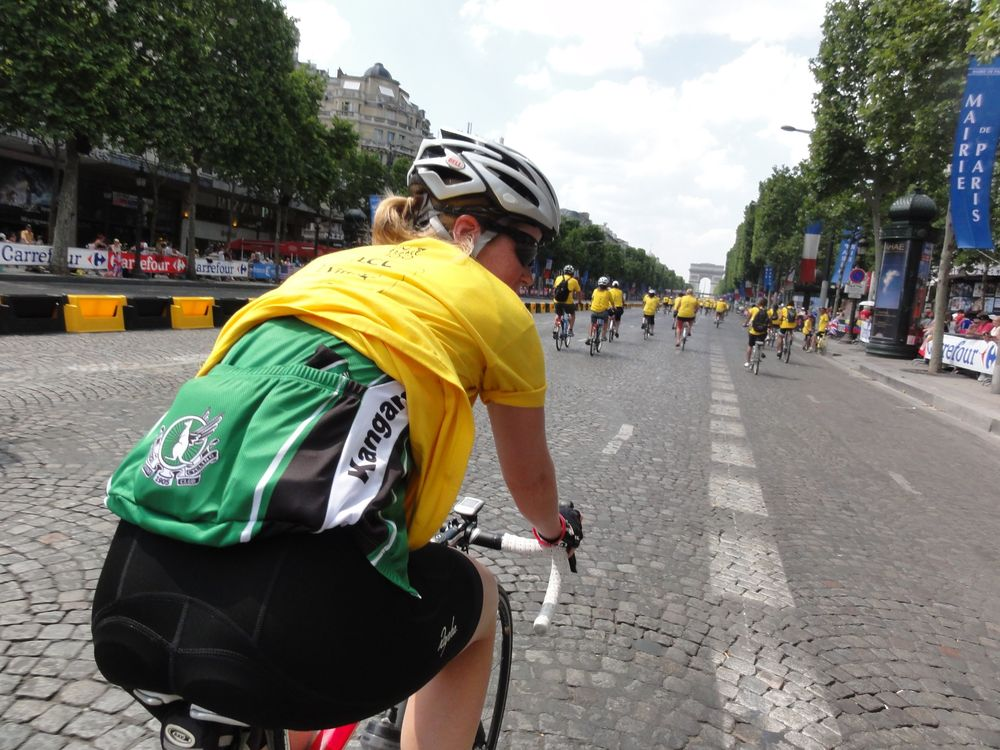 A little bit of TeamKP on the Champs-Elysees.  Well done to Claire for wearing her jersey in the searing heat under her t-shirt just for this photo!