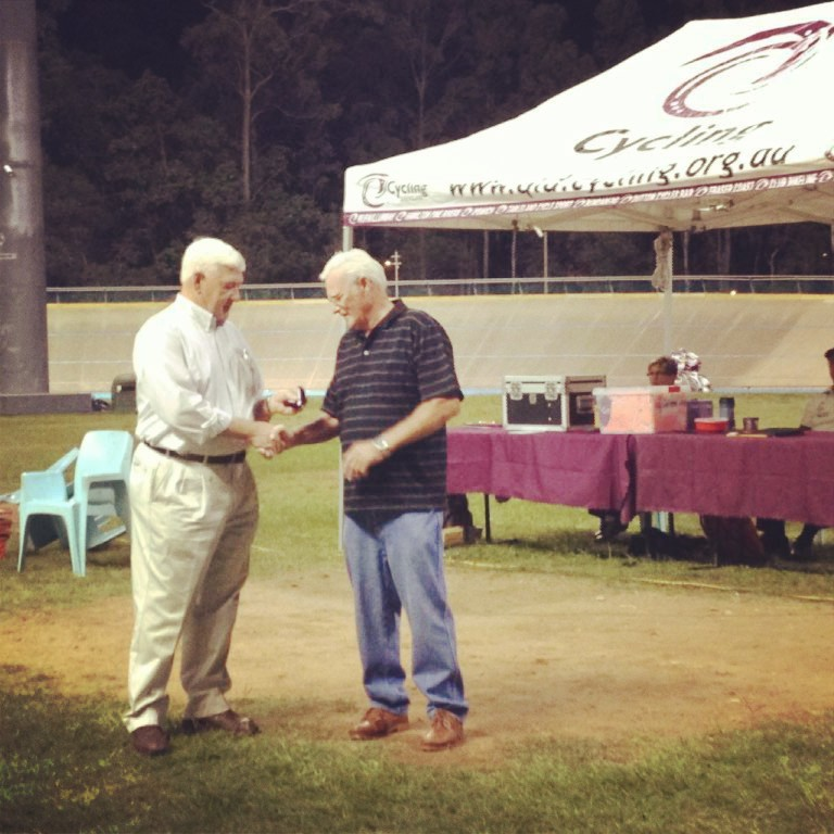 Mr Peter Rasell receives his Life Membership from Mr Mike Victor OAM President of Cycling Queensland at the 2013 Queensland Track Championships.