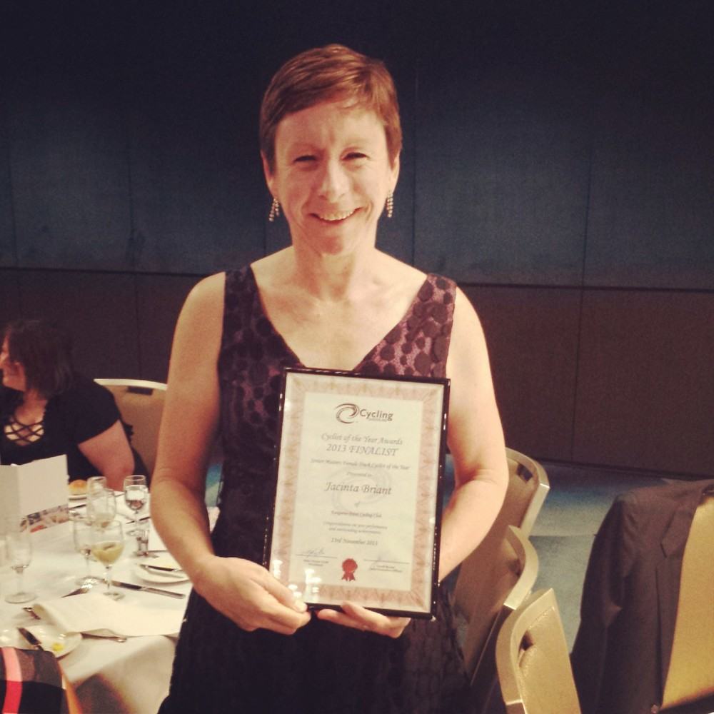 Mrs Jacinta Briant with her framed award certificate.