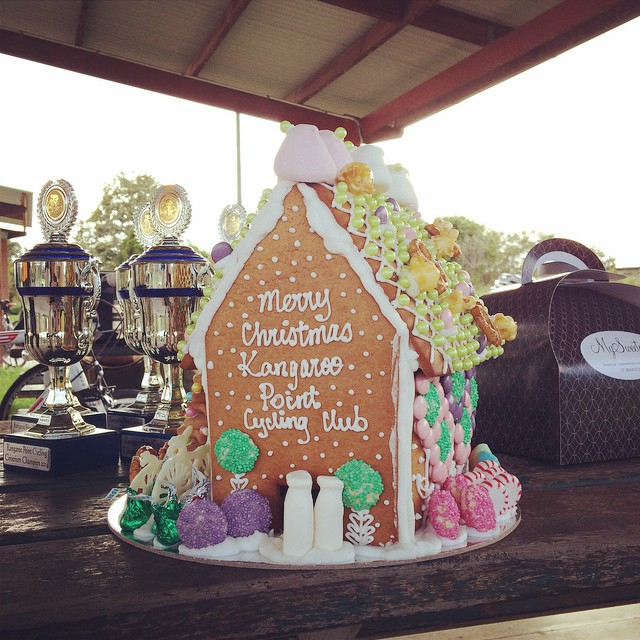 MySweetopia dropped by the racing to present the Club with a Gingerbread house!