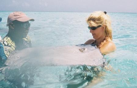 Toni getting friendly with a stingray at Stingray City