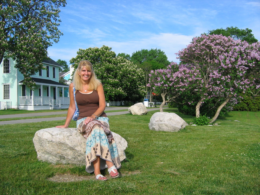 Toni near the shore on Mackinac Island – the lilacs were in bloom.