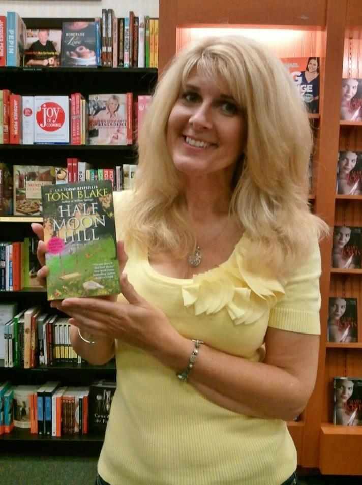 Toni with a copy of the newest Destiny book, Half Moon Hill.
