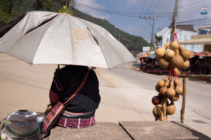 A hill-tribe woman selling souvenirs on a hot day, Doi Mae Salong.