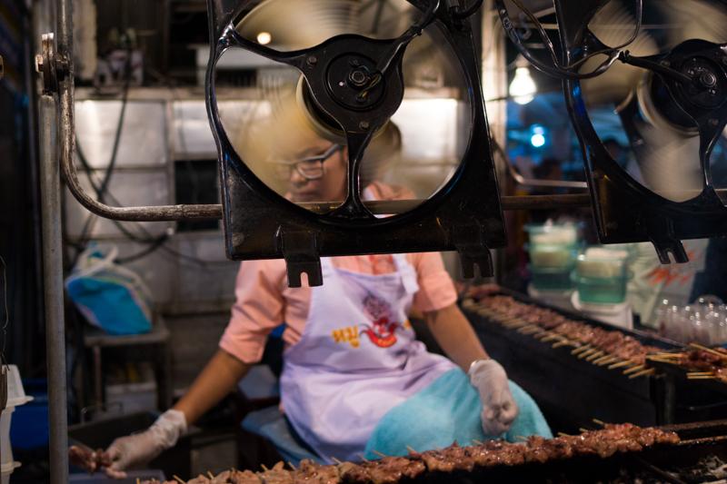Barbecue vendor, in Bangkok, Thailand.