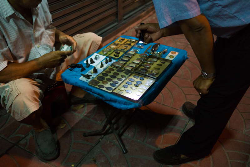 Small street stall selling amulets in Bangkok, Thailand.