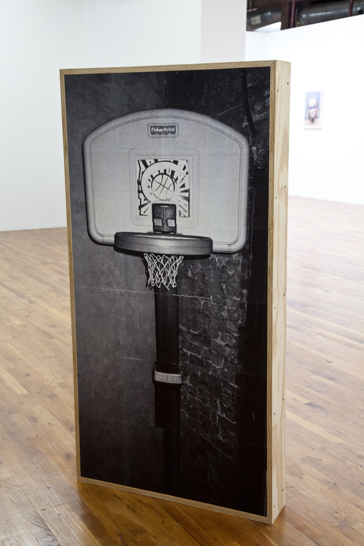 East Village: Basketball Hoop/Fire Extinguisher (front) 2012 Tiled photograph, wood panel, wood frame, gel medium, screws 61 1/2 x 31 1/2 x 6 inches