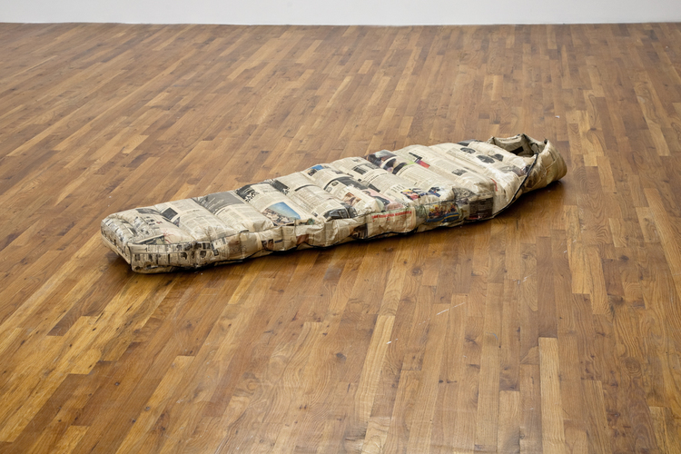 Andrew Sutherland Sleeping Bag 2011 Newspaper, Polystuff, Glue, Acrylic Medium, Thread and Zipper 28 1/2 x 79 x 7 1/2 inches
