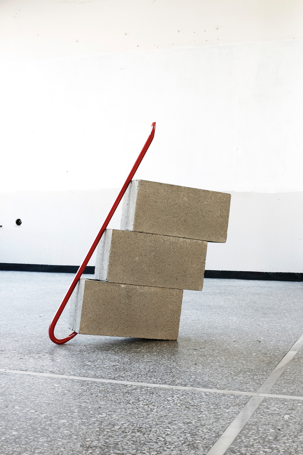 Dylan Lynch  Standing Alone with Three Cinder Blocks (Red)  2013 Crowbar, cinder blocks  32 x 27 x 5.5 inches