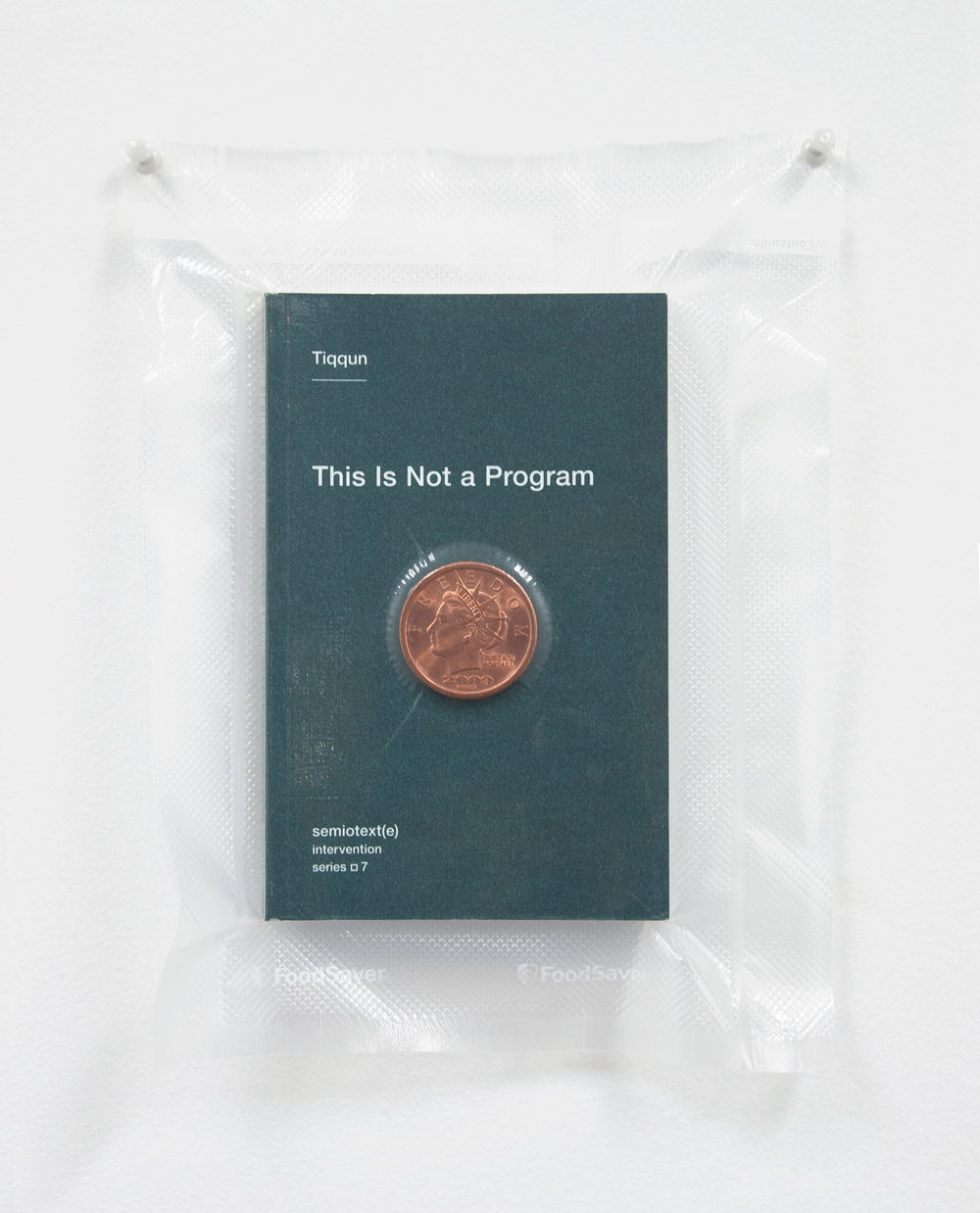 Brad Troemel  TSA No Fly List Vacuum Sealed Tiqqun     -'This is Not a Program' with AOCS $20 solid copper liberty coin  , 2013   10 x 8 inches