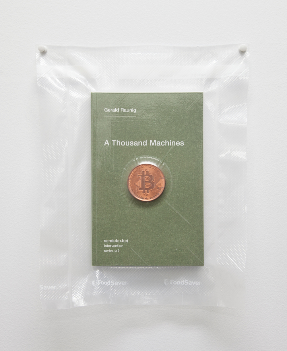 Brad Troemel   TSA No Fly List Vacuum Sealed Gerald Raunig, - 'A Thousand Machines' with AOCS, copper Bitcoin  , 2013      10 x 8 inches