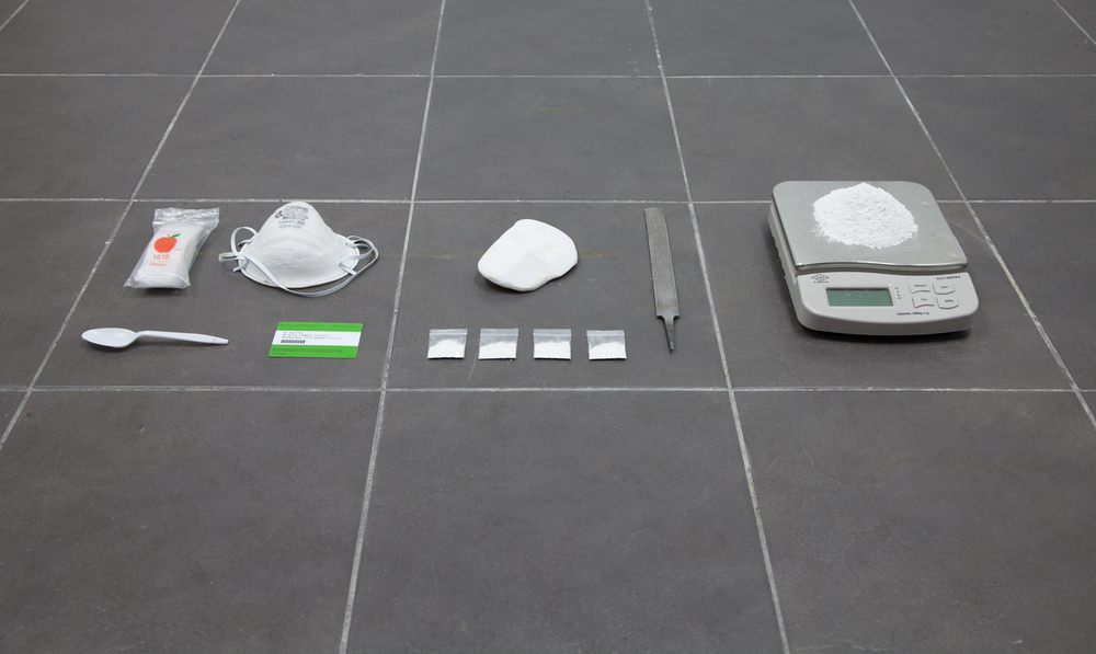 Isaac Brest    This Shit Right Here,  N****?!  , 2013      Plastic baggies, dust mask, salvaged stone from Parthenon, metal file, salvaged stone from Parthenon filed down to powder, four plastic baggies containing one gram of Parthenon powder, Metropolitan Museum membership card, plastic spoon       Dimensions variable