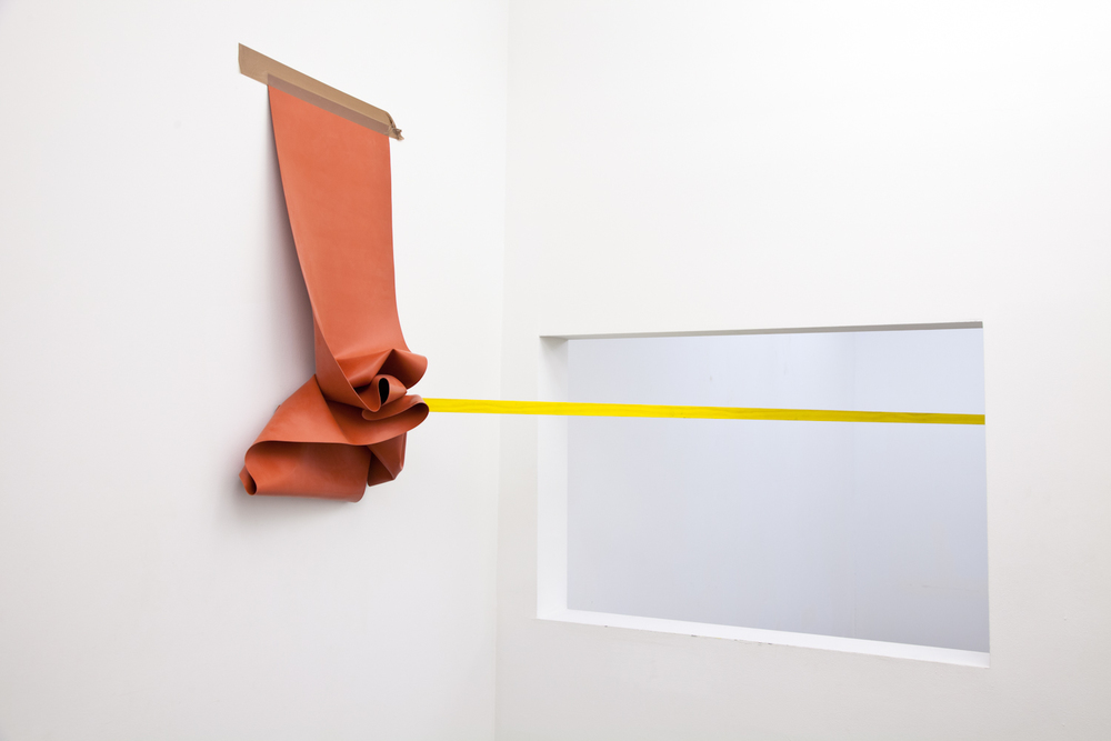 Zachary Susskind  Shoe Cumber  2012 Tape, silicone, rubber, latex, ink, lacquer on wood Dimensions variable