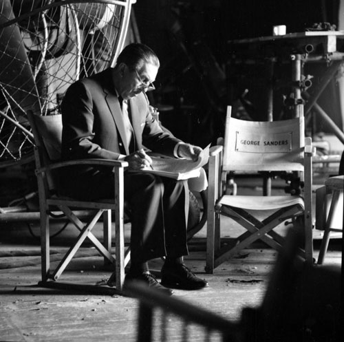 Walt going over script next to George Sanders chair InSearch2662.jpg