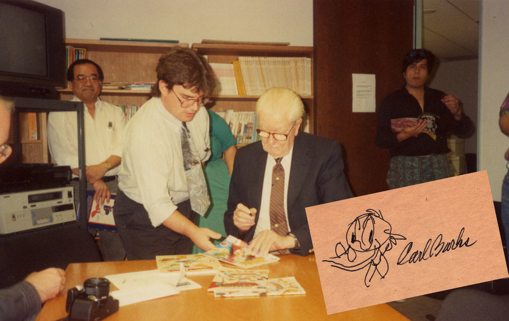 Artist, Bill Riling has his books autographed while Willie Ito and Phil Ortiz wait in the background.