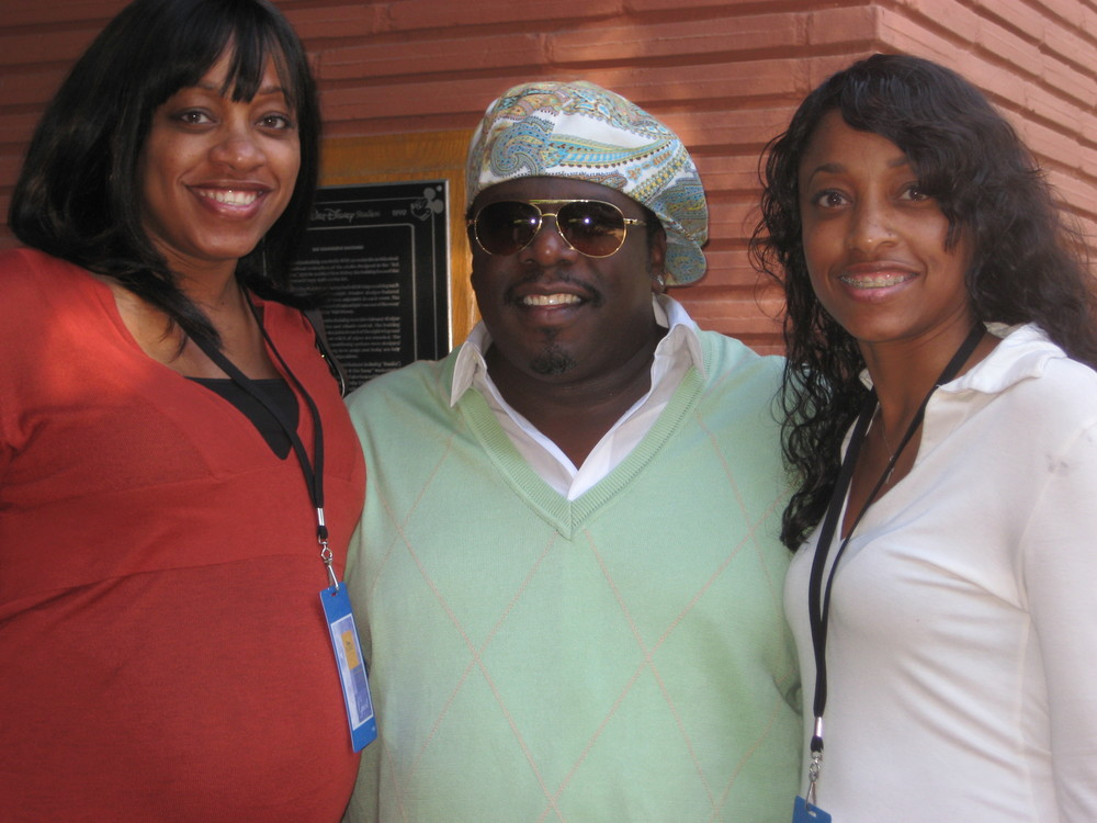 "It's my own Walt Disney's ""The Parent Trap."" That's Cedric the Entertainer with my twin daughters. Yes, it's Disney's fault."