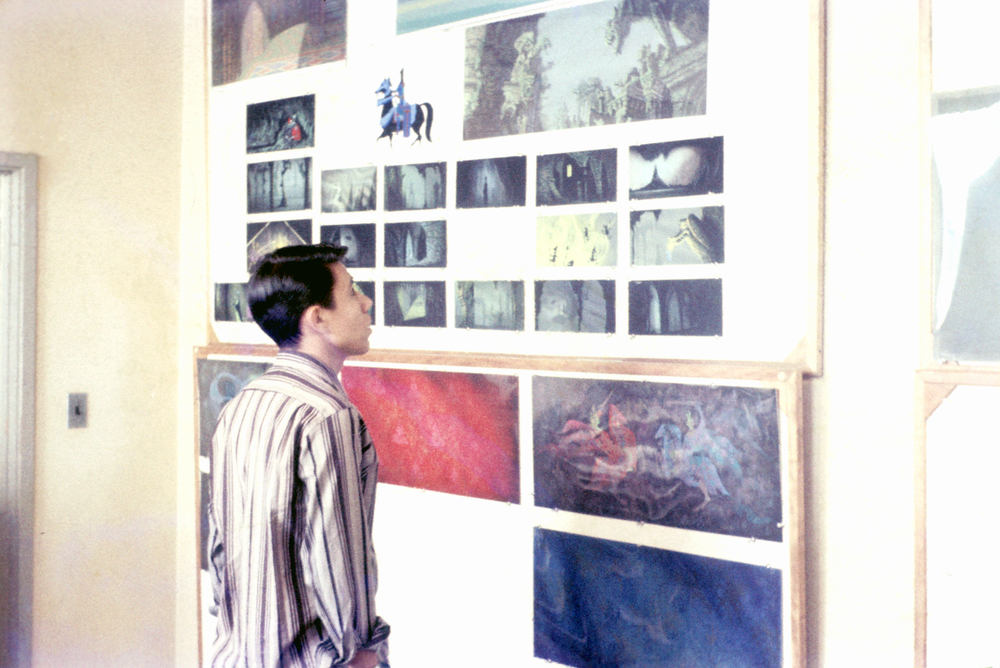 Rick Gonzales studies the color scripts of Malificent's Lair for the Disney film, Sleeping Beauty. When I snapped this photograph of my pal, the Master Artist, Eyvind Earle was actually in the room. This photo was taken in 1957.