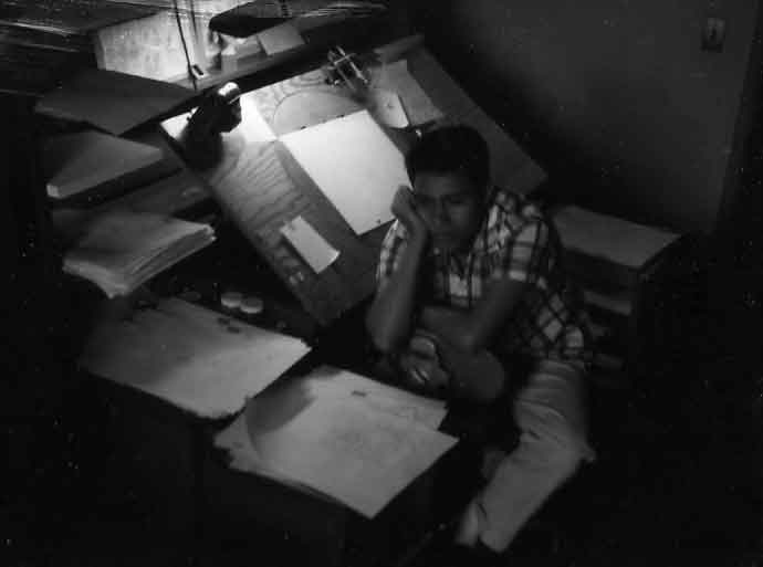Animation artist, Rick Gonzales is deep in thought at his drawing board. The year is 1958 at the Walt Disney Studio in Burbank.