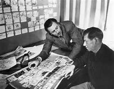 Walt and Jaxon. Walt Disney in a serious story session with director, Wilfred Jackson.